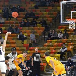 Utah State's Rollie Worster shoots a free throw during the Aggies' 72-59 victory over Wyoming on March 4, 2021, at the Spectrum in Logan.