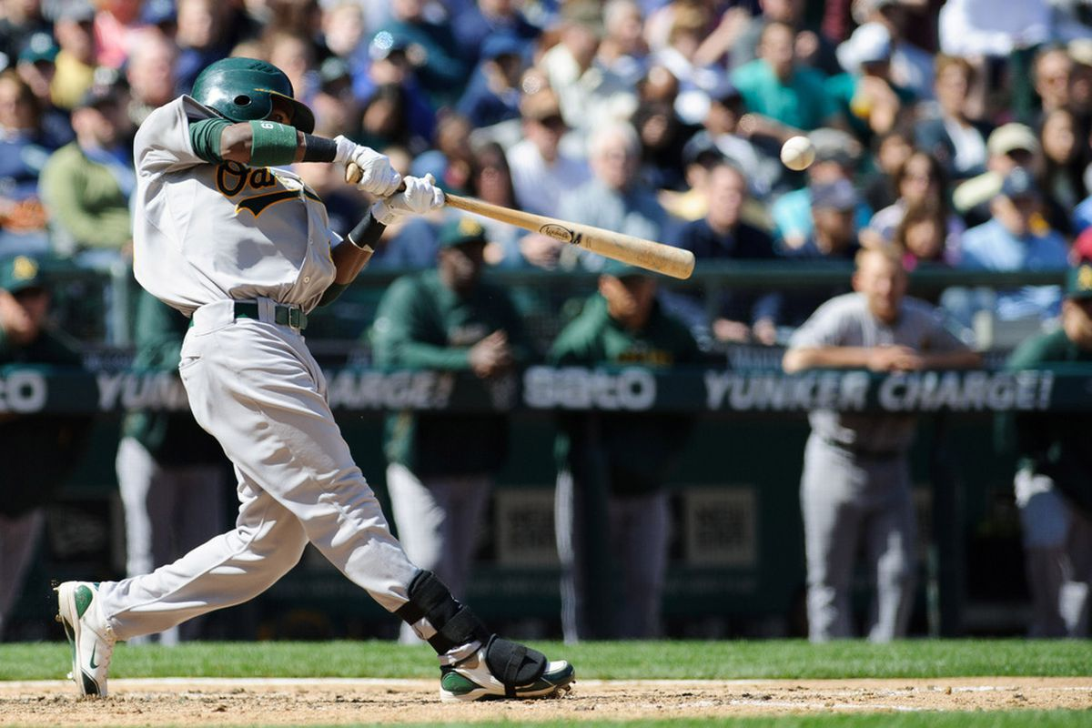 Apr 15, 2012; Seattle, WA, USA; Oakland Athletics second baseman Jemile Weeks (19) hits a single against the Seattle Mariners in the 3rd inning at Safeco Field. Mandatory Credit: Steven Bisig-US PRESSWIRE