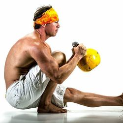 """<a href=""""http://vegas.racked.com/archives/2014/08/18/hottest-trainer-contestant-6-martin-hinton.php"""">Martin Hinton, director and an instructor at TruFusion Yoga</a>"""