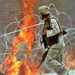 A Marine of the 1st Division leaves his base for a mission outside Fallujah, Iraq.