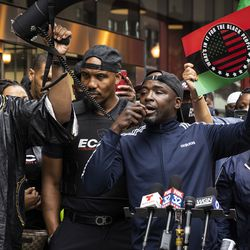 Mark Carter, executive director of Black Contractors United, speaks during a rally outside the Chicago Housing Authority headquarters in the Loop, decrying economic disparities for black communities in the city, Monday morning, May 3, 2021.