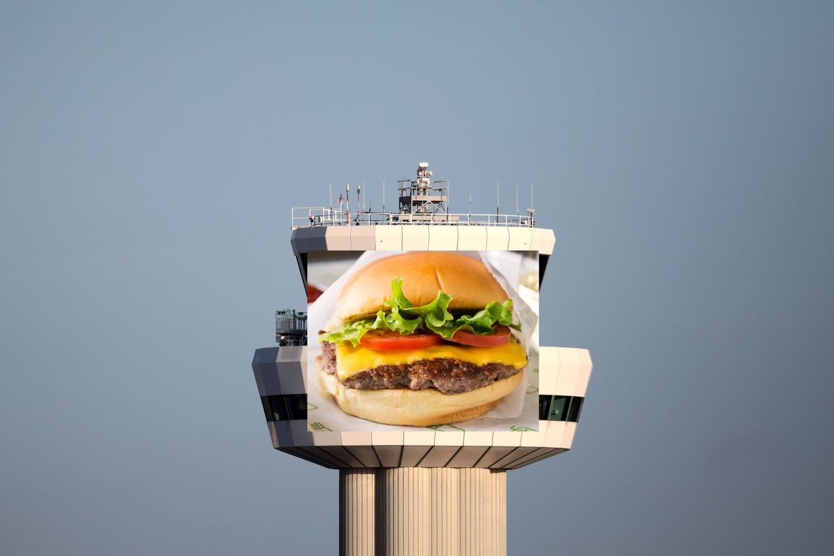 A Shake Shack logo photoshopped on to the control tower at Gatwick Airport in London