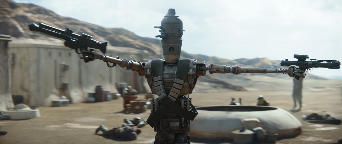 IG-11 (Taika Waititi) cleans house in chapter 1 of The Mandalorian. From Disney Plus' The Mandalorian.