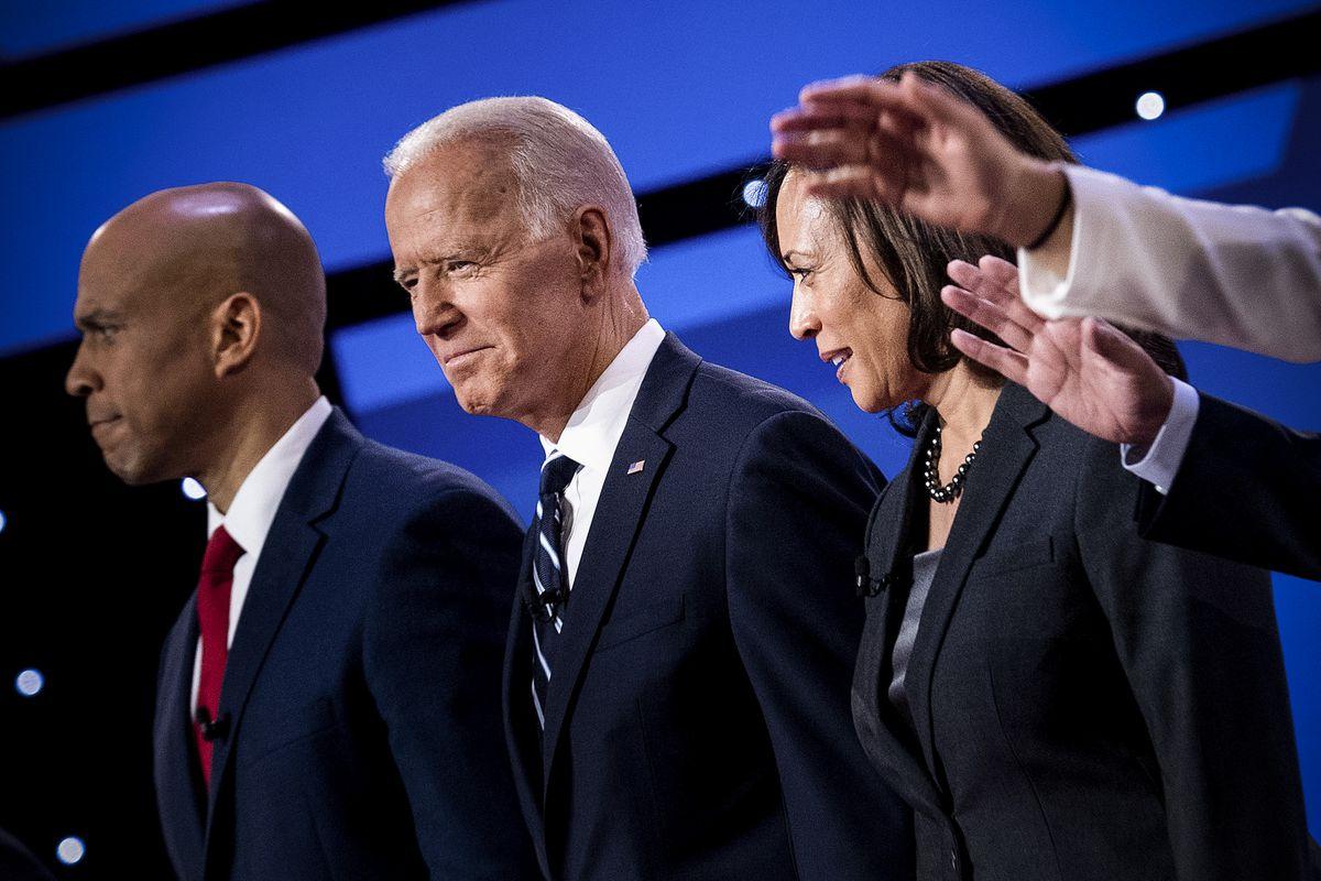 Democratic presidential hopefuls Sen. Cory Booker (D-NJ), former Vice President Joe Biden (center) and Sen. Kamala Harris (D-CA) arrive on stage ahead of the second round of the second Democratic primary debate on July 31, 2019.