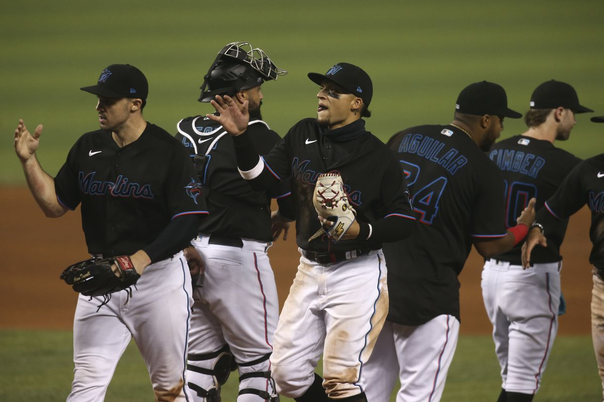 Miami Marlins second baseman Isan Diaz (1) celebrates with teammates after defeating the Milwaukee Brewers at loanDepot park.