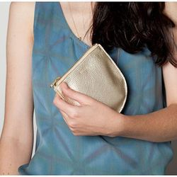 """Baggu Small Leather Pouch from the ICA, <a href=""""http://www.icastore.org/store/product/21930/Small-Leather-Pouch%3A-Gold/"""">$25</a>, for the college student to keep it all in one place."""