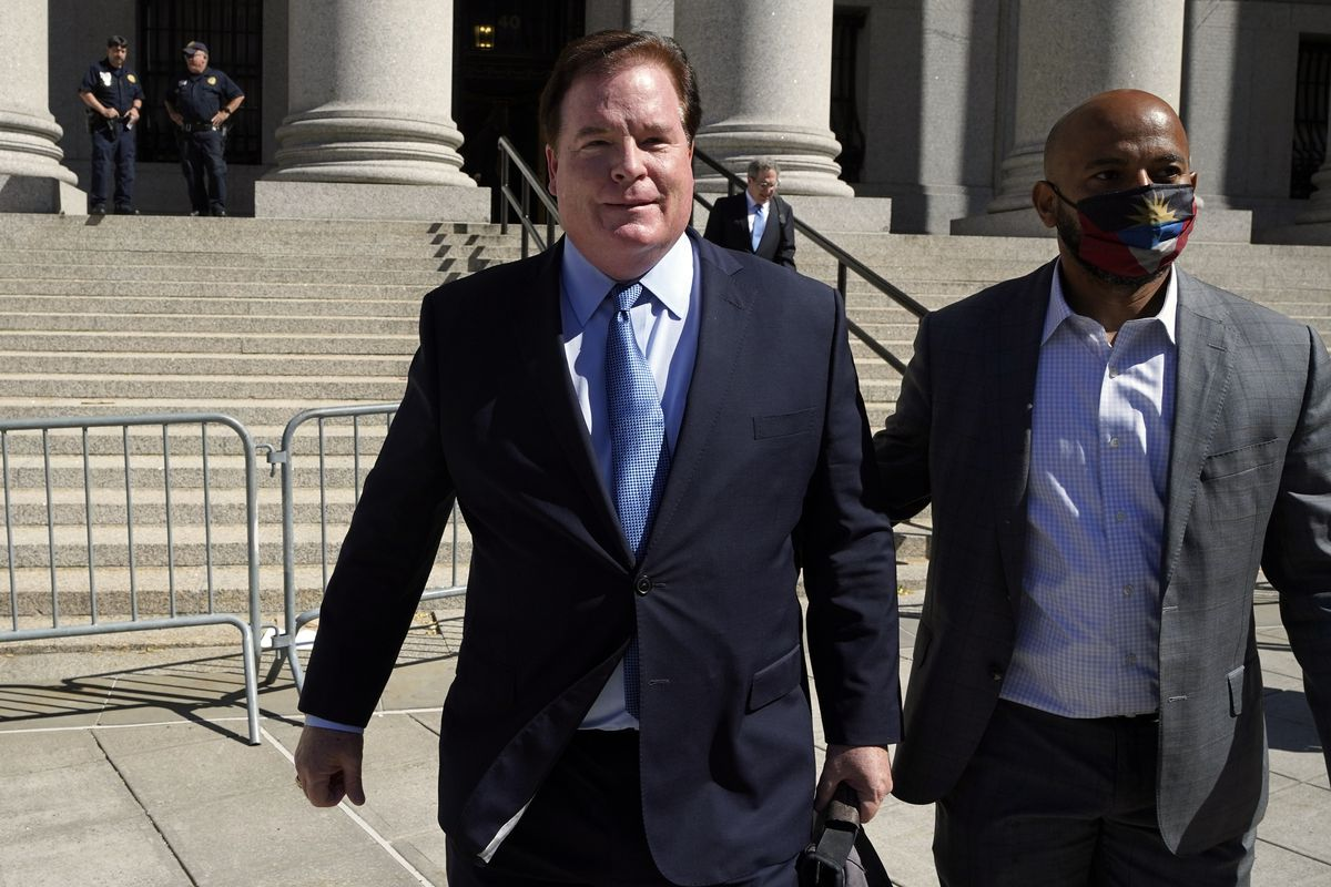 Chicago banker Stephen Calk, left, leaves Federal court in New York, Thursday, June 24, 2021. He was convicted on charges that he tried to buy himself a senior post in former President Donald Trump's administration by making risky loans to Trump onetime campaign chairman, Paul Manafort.