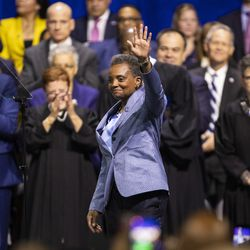 Mayor Lori Lightfoot waves to the crowd after taking the oath of office during the city of Chicago's inauguration ceremony at Wintrust Arena, Monday morning, May 20, 2019.