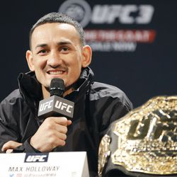 Max Holloway answers a question.