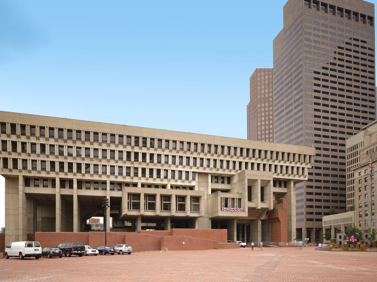 The exterior of the Boston City Hall. The building has a flat roof and many windows.