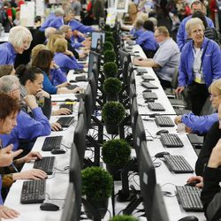 Numerous attendees work at the Family History Library's Cyber Cafe during the RootsTech conference in Salt Lake City Friday, Feb. 13, 2015.