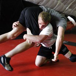 """Doug Schulte, bottom, who has been living with L-CHAD  an """"Orphan"""" disease, wrestles with Kevin Clem, at Kingdom Klub in Woods Cross."""