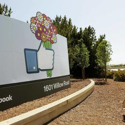 This May 11, 2012, photo shows a sign is shown at the Facebook campus in Menlo Park, Calif.  Silicon Valley, it turns out, doesn't revolve around the stock prices of Facebook and its playful sidekick, Zynga. Instead, the optimism in Silicon Valley can be seen in a variety of ways in this area that covers roughly 40 miles from San Jose to San Francisco