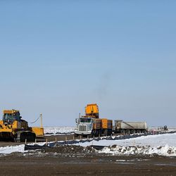 Construction of a temporary road to access the new prison site is underway in Salt Lake City on Wednesday, Dec. 28, 2016.