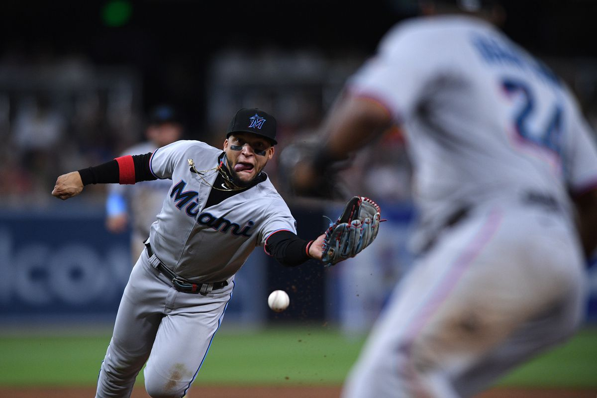 Miami Marlins second baseman Isan Diaz (left) tosses the ball with his glove to first baseman Jesus Aguilar (24) on a ground out by San Diego Padres first baseman Eric Hosmer