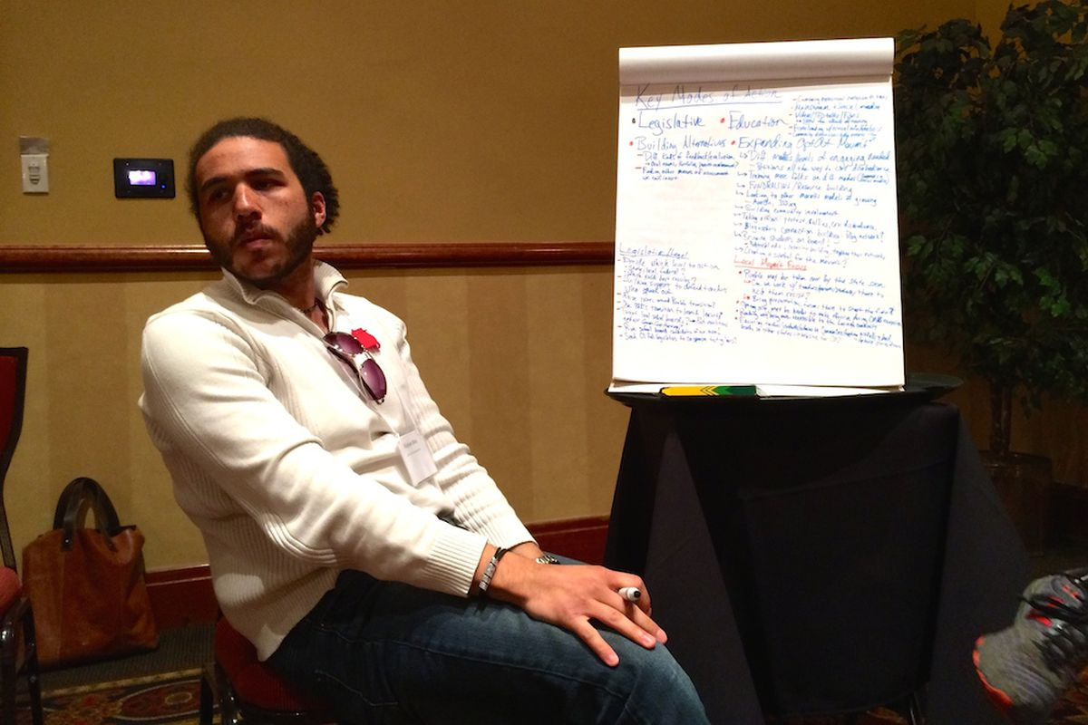 Roshan Bliss, an organizer from the Colorado Student Power Alliance, takes notes during a work session Saturday at the United Opt-Out conference in downtown Denver.