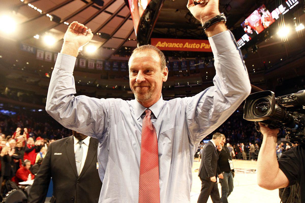 Utah Utes head coach Larry Krystowiak celebrates after his team wins the Ameritas Insurance Classic against the Duke Blue Devils at Madison Square Garden in New York City, Saturday, Dec. 19, 2015.