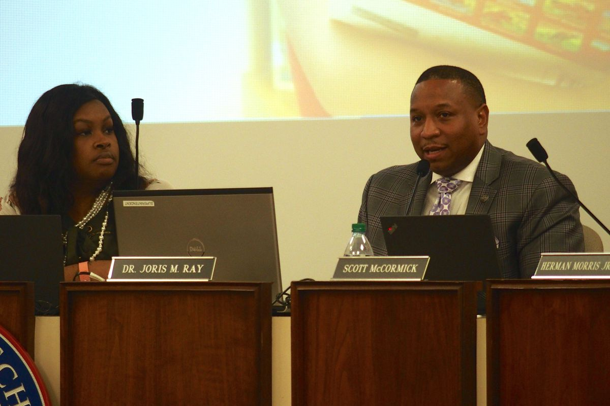 Interim superintendent Joris Ray responds to the flood of support at a February school board meeting.
