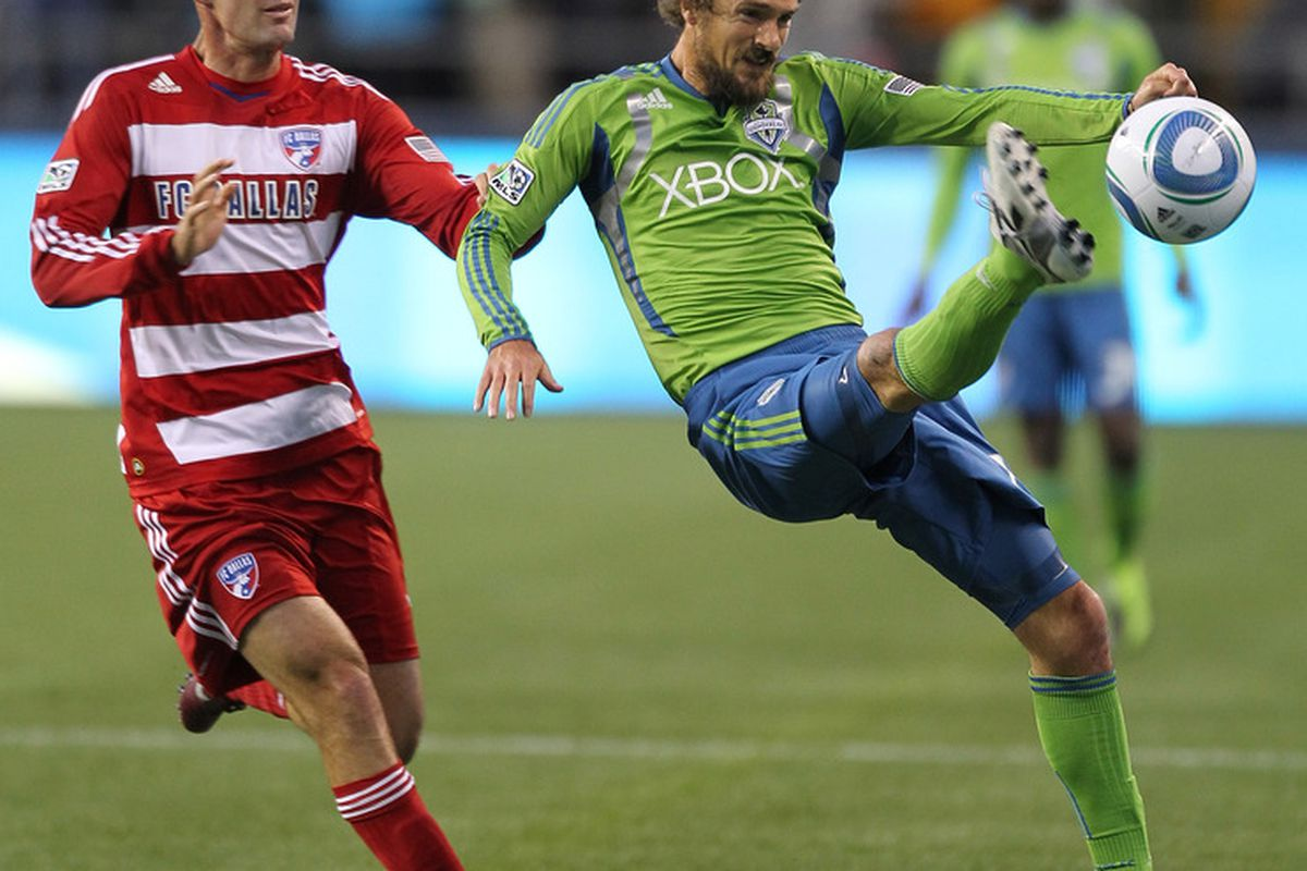 SEATTLE - MAY 25:  Roger Levesque #24 of the Seattle Sounders FC passes against Andrew Jacobson #4 of FC Dallas at Qwest Field on May 25, 2011 in Seattle, Washington. FC Dallas defeated the Sounders 1-0. (Photo by Otto Greule Jr/Getty Images)