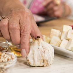Roasted garlic is used in the vinaigrette dressing.   Ashlee Rezin/Sun-Times