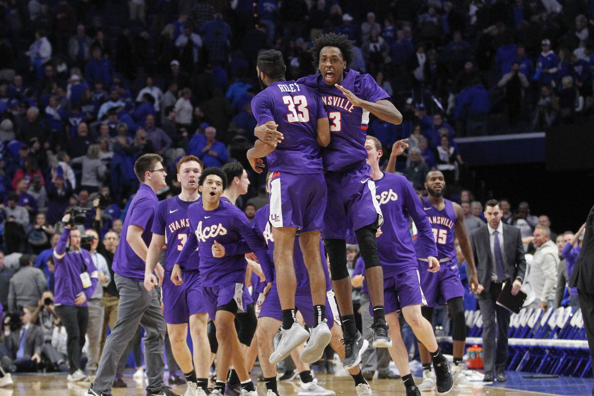 Evansville Purple Aces guard K.J. Riley celebrates with forward DeAndre Williams after defeating the Kentucky Wildcats at Rupp Arena.