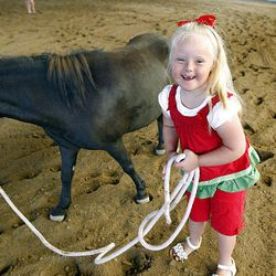 Aubry Alldredge, 6, walks Bella at Buffalo Ranch in Farmington on Thursday as part of a therapeutic riding program organized by the nonprofit group Therapeutic Assets.