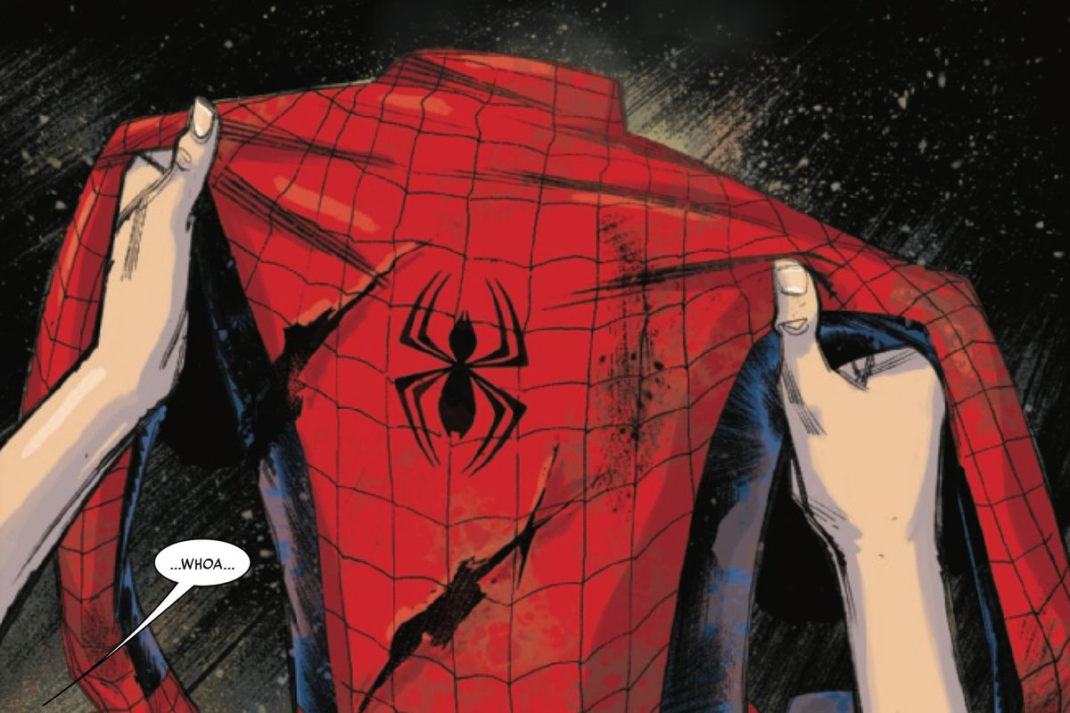A torn Spider-Man costume, held in two hands, from Spider-Man #1, Marvel Comics (2019).