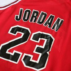 "1995 Michael Jordan champion jersey, $65 from <a href=""http://topshelfpremium.com/"">Top Shelf Premium Vintage"