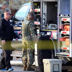 FILE - Military personnel check equipment on one of their trucks as Local and federal agencies respond to a fentanyl drug bust in Cottonwood Heights on Tuesday, Nov. 22, 2016.