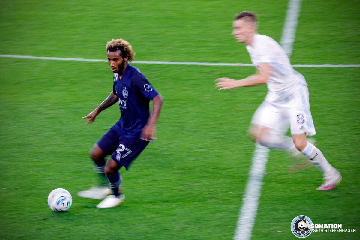 August 21, 2020 - Saint Paul, Minnesota, United States - Sporting KC midfielder Gianluca Busio (27) breaks away from Minnesota United midfielder Ján Greguš (8) during the match at Allianz Field.