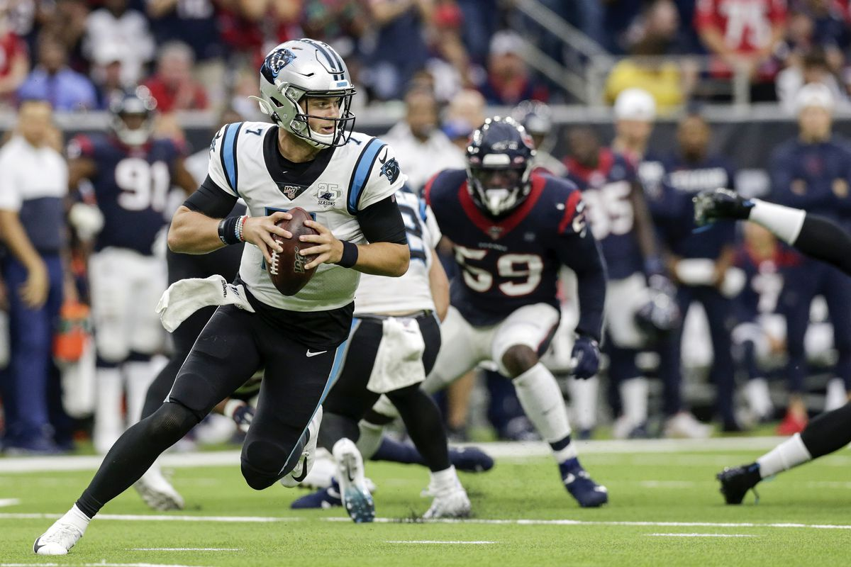 Kyle Allen of the Carolina Panthers rolls out to pass in the second half against the Houston Texans at NRG Stadium on September 29, 2019 in Houston, Texas.