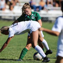 Murray's Sammie Sofonia (13) tackles against Olympus' Mary Anderson (18) during a girls soccer game at Olympus High School in Holladay on Thursday, Sept. 3, 2020.
