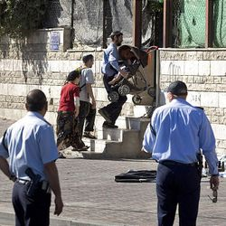 Israeli Jews enter a house after police evicted its Palestinian residents in the East Jerusalem neighborhood of Sheikh Jarrah Sunday.