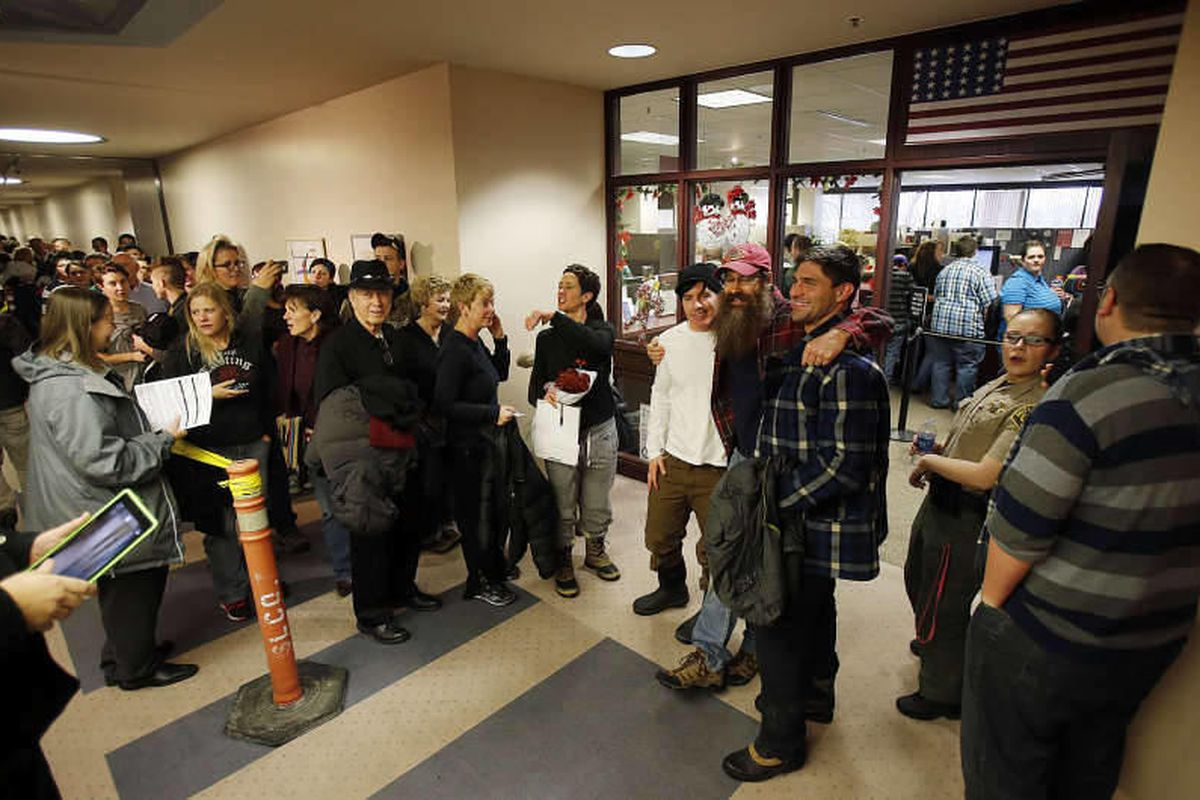 Couples wait to get marriage licenses outside the Salt Lake County clerk's office, Monday, Dec. 23, 2013.
