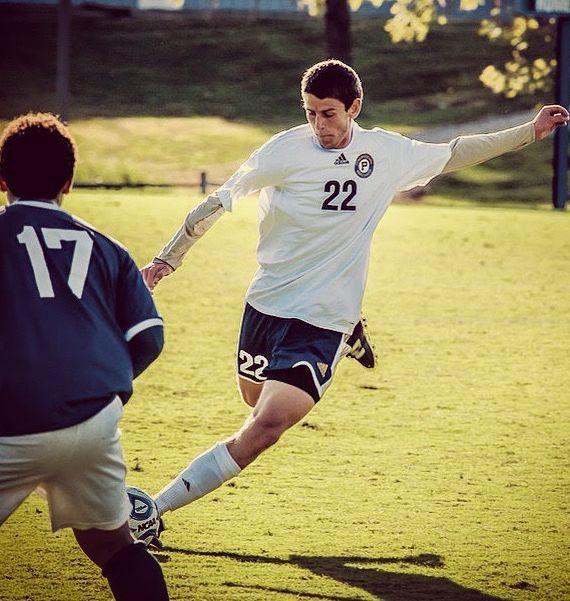 Ross Furbush kicks a soccer ball