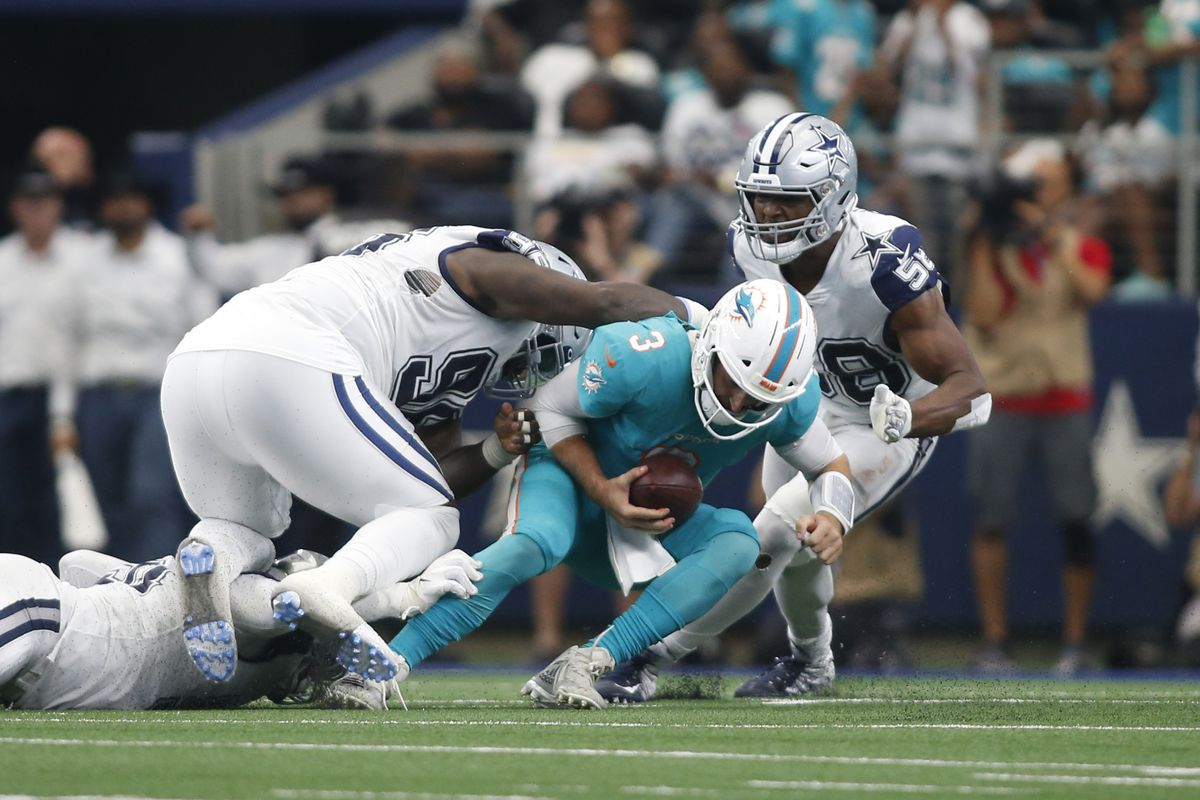 Dallas Cowboys defensive tackle Maliek Collins sacks Miami Dolphins quarterback Josh Rosen in the fourth quarter at AT&T Stadium.