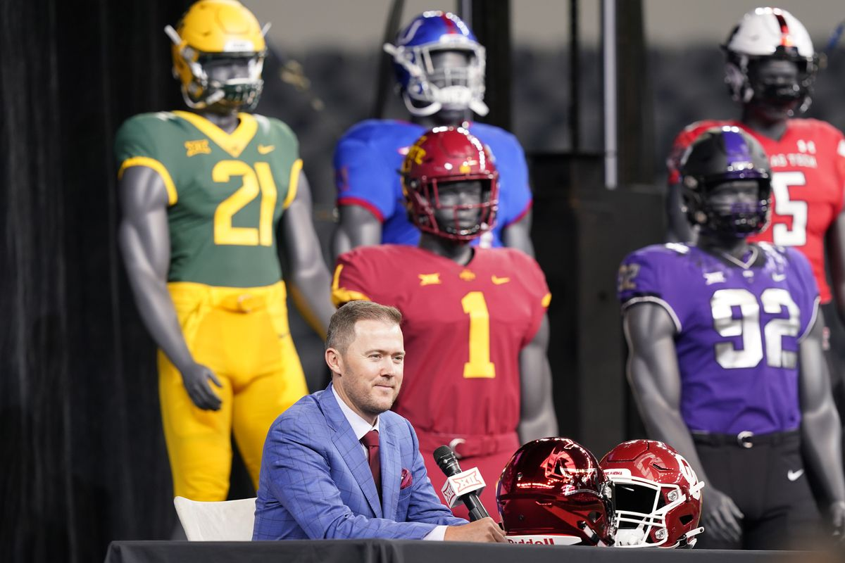 Oklahoma football coach Lincoln Riley speaks with mannequins in the background during Big 12 media days last week.