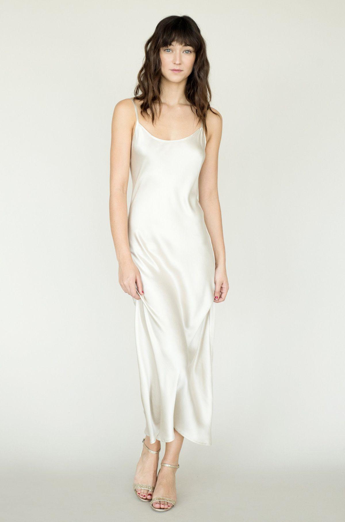 A model wearing a white slip dress