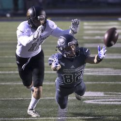 Corner Canyon wide receiver Harrison Taggart, right, dives for a pass as Lone Peak's Justin Ostler defends the play during a football game at Corner Canyon in Draper on Friday, Sept. 27, 2019.