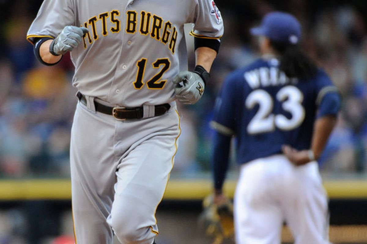 June 3, 2012; Milwaukee, WI, USA;  Pittsburgh Pirates shortstop Clint Barmes (12) rounds the bases after hitting a home run in the ninth inning against the Milwaukee Brewers at Miller Park.  Mandatory Credit: Benny Sieu-US PRESSWIRE