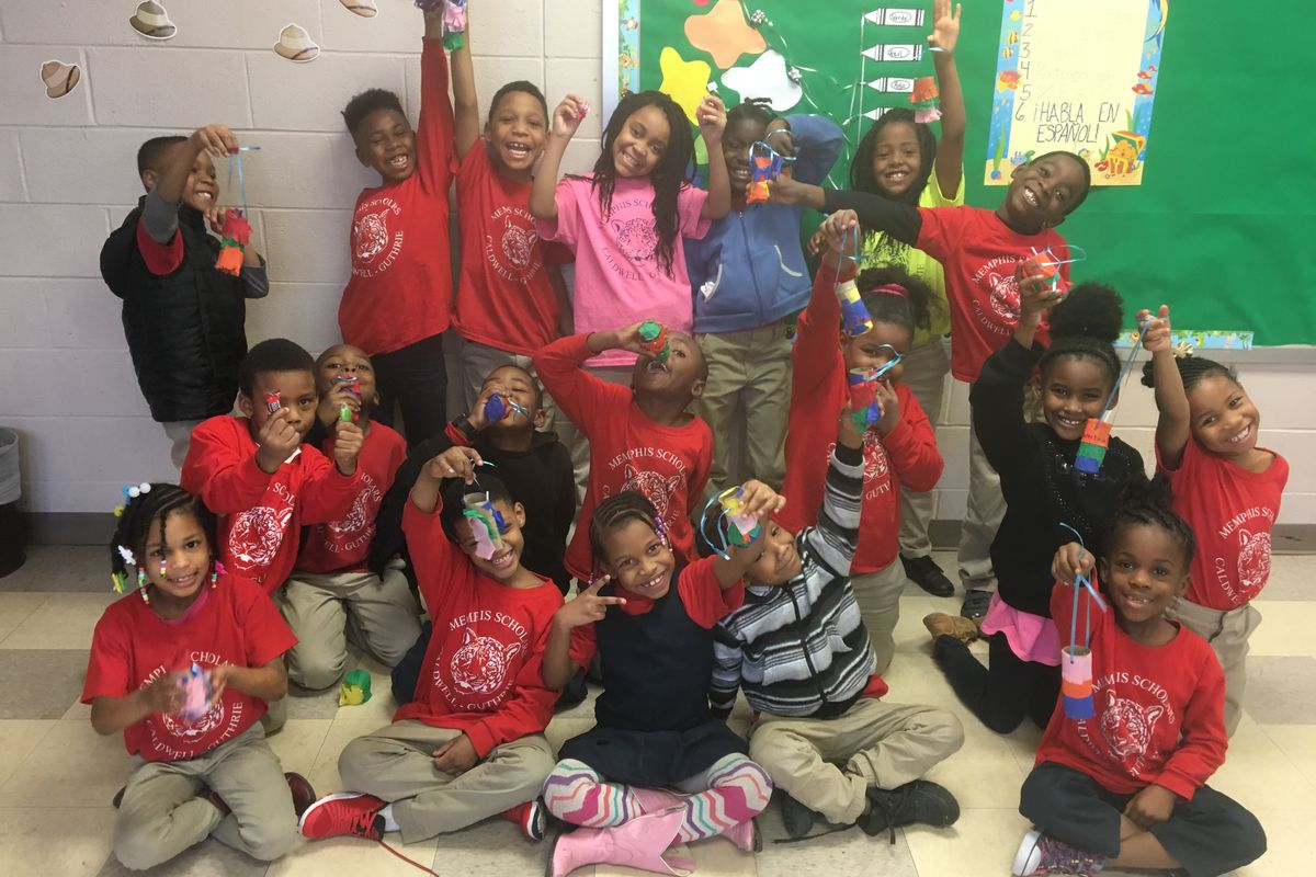 Students show off their homemade piñatas in Kylie Cucalon's Spanish class at Caldwell-Guthrie Elementary, a charter school operated by Memphis Scholars.