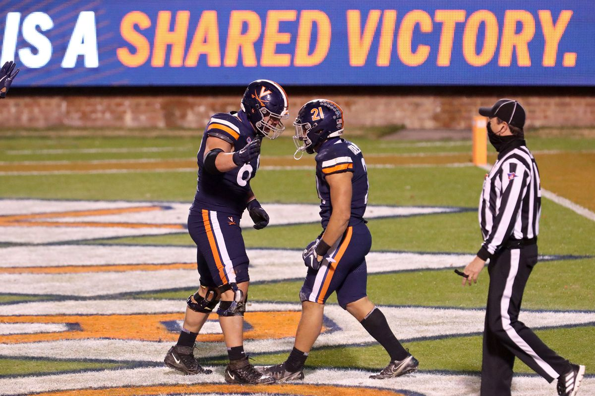 Chris Glaser and Wayne Taulapapa of the Virginia Cavaliers celebrate a touchdown in the second half during a game against the Boston College Eagles at Scott Stadium on December 5, 2020 in Charlottesville, Virginia.