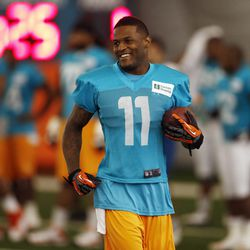 Jul 22, 2013; Davie, FL, USA; Miami Dolphins wide receiver Mike Wallace (11) during  training camp at the Doctors Hospital Training Facility at Nova Southeastern University.