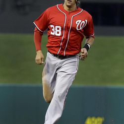 Washington Nationals' Michael Morse rounds the bases after hitting a grand slam during the first inning of a baseball game against the St. Louis Cardinals , Sept. 29, 2012, in St. Louis.