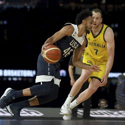 United States' Joe Harris, left, drives to the basket past Australia's Joe Ingles during their exhibition basketball game in Melbourne, Saturday, Aug. 24, 2019.