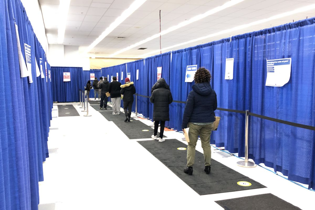 Voters wait to cast their ballots on Thursday, Oct. 29, 2020 at the Chicago Board of Elections' Super Site in the Loop.