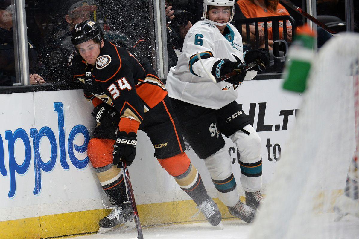 September 20, 2018; Anaheim, CA, USA; Anaheim Ducks center Sam Steel (34) plays for the puck against San Jose Sharks defenseman Ryan Mekrley (6) during the first period at Honda Center.