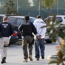 In this March 30, 2012 photo, Immigration and Customs Enforcement (ICE) agents take a suspect into custody as part of a nationwide immigration sweep in Chula Vista, Calif. Federal officials say they arrested more than 3,100 immigrants convicted of serious crimes and fugitives in a six-day nationwide sweep.  Officials at U.S. Immigration and Customs Enforcement say the sweep included every state and involved more than 1,900 of the agency's officers and agents.
