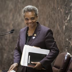 Mayor Lori Lightfoot smiles while receiving a round of applause following adjournment of her first Chicago City Council meeting at City Hall, Wednesday, May 29, 2019.