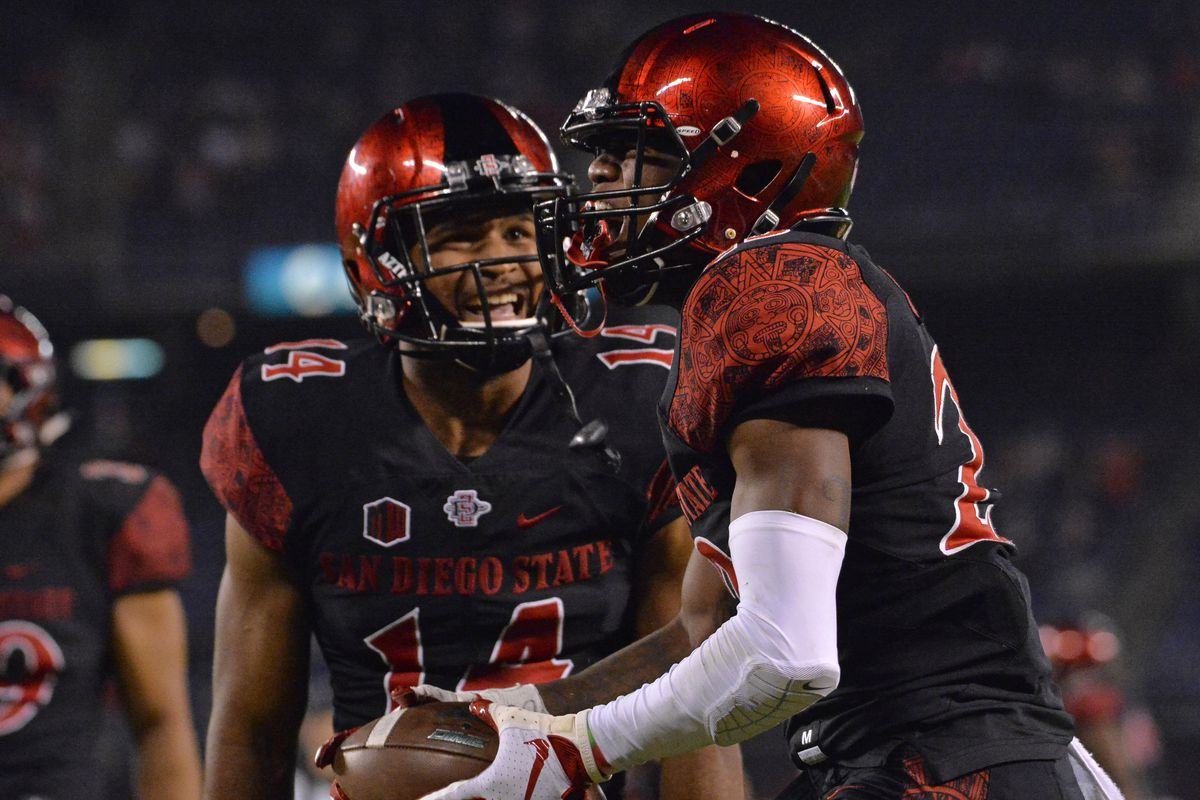 San Diego State cornerback Darren Hall celebrates with safety Tariq Thompson after making an interception in overtime against Eastern Michigan at SDCCU Stadium.